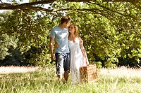 A young couple carrying a picnic basket (thumbnail)