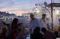 Africa, Morocco, Marrakech. Jemaa el Fna square, crowd and foodstalls