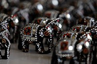 Elephant figurines decorated with mirrors and beads