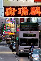 Neon signs at night with traffic. Hong Kong, China
