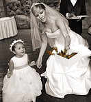 View of a bride releasing butterflies with a flower girl.
