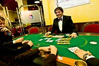 Italy, Val D'Aosta, Saint Vincent, croupier at poker table