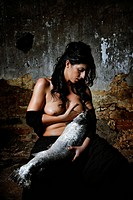 Woman breastfeeding a big fish
