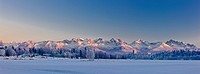 Panoramic view of the sunset casting a pink glow over the Chugach Mountains, Anchorage, Southcentral Alaska, Winter