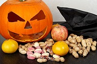 the spoils from trick or treating with halloween pumpkin jack-o-lantern  Traditionally in Ireland turnips or swedes were used to create the lanterns a...