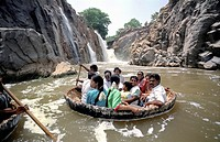 Tourists enjoying coracle ride at Hogenakkal, Tamil Nadu, India