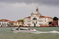 Venetian boat across the Grand Canal in Venice, Italy