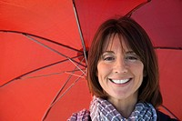 Mature woman under umbrella, portrait