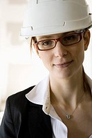 Female architect in hard hat, portrait