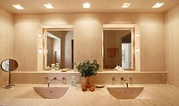 His and her sinks and mirrors in bathroom