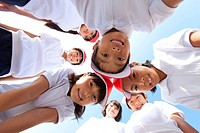 Elementary school children and teacher looking into camera, Japan