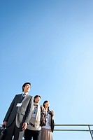 Young businessman and businesswomen standing side by side