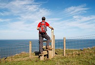 Male hiker on The Cleveland Way national trail near Staithes, North Yorkshire, England, United Kingdom The Cleveland Way is 109 miles in total, starti...