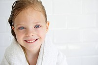 Girl in a bath towel, looking at camera