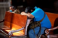 A man prays in Mexico City's Metropolitan Cathedral. In times of epidemic, Mexico City's Cathedral calls on the Christ of Health to help rid the natio...