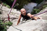 Rock climber climbing