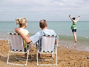 Seniors watch granddaughter on beach