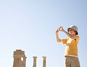 Boy taking photo at historical ruins