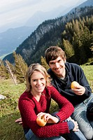 Couple eating apples while resting
