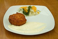 Dungeness crab cake with tartar sauce and salad