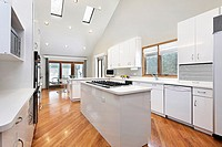 Luxury kitchen with white cabinetry and island