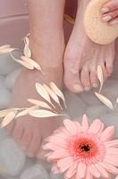 Woman taking footbath