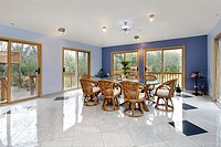 Large eating area in luxury home with doors to patio