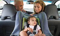 Young family with small girl 12_18 months sitting in car