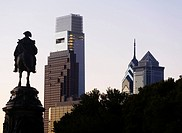 USA, Pennsylvania, Philadelphia, Silhouette of statue, Skyscrapers in background