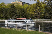 Tour boat on the Rideau Canal in springtime, Ottawa, Ontario, Canada