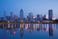 Montreal skyline reflected in the Lachine Canal at dawn, Quebec, Canada