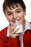 Boy holding a glass of milk.