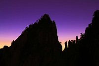 Pinnacle in the Yellow Mountains silhouetted at dawn, Anhui, China