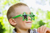 Little boy with star sunglasses