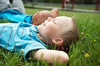 Boys laying in grass (thumbnail)