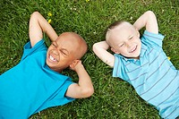 Boys laying in grass