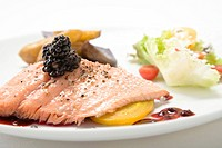 Salmon with blackberries on top