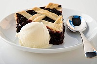 Slice of blackberry pie and ice cream