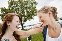 Young women playing in park (thumbnail)