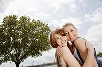 Young women hugging in park
