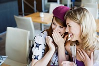 Young women laughing in cafe