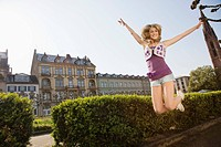 Young woman jumping at university
