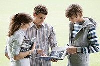 Students looking at textbook