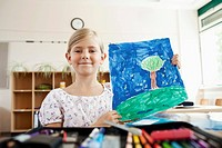 Girl with painting in classroom