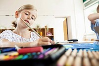 Girl painting in classroom