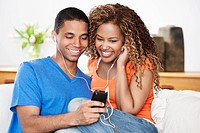 Young couple sharing an MP3 player