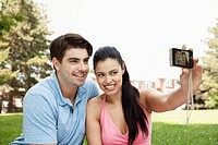 Young couple taking a self portrait (thumbnail)