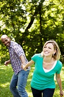 Playful young couple in a park