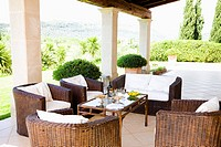Wicker chairs on villa patio