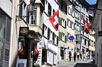 Zurich (Switzerland): street in the city's center with the Swiss flag, during Switzerland´s national day (August 1st)